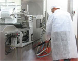 cleaning off food spills and residues from processing lines and preparation surfaces